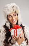 Portrait of a young woman holding a present Royalty Free Stock Image