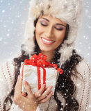 Portrait of a young woman holding a present Stock Photos