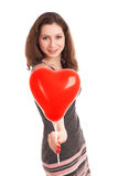 Portrait of young woman holding red balloon Stock Images