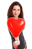 Portrait of young woman holding red balloon Royalty Free Stock Image