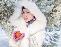Portrait of young woman holding red heart Royalty Free Stock Image