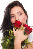 Portrait of young woman holding red roses Stock Images