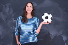 Woman holding a soccer ball in front of chalk drawing board Stock Photography