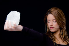 Portrait of young woman holding stone Stock Photography