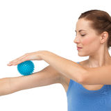 Portrait of a young woman holding stress ball on arm Royalty Free Stock Image