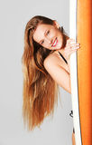 Portrait of young woman holding surfboard Royalty Free Stock Photography