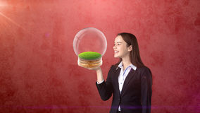 Portrait of young woman holding transparent orb on the open hand palm with empty copyspace. Business concept Royalty Free Stock Photo
