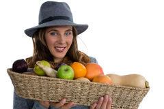 Portrait of young woman holding vegetables in wicker basket Royalty Free Stock Photography