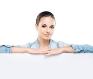 Portrait of a young woman holding a white banner Stock Photography