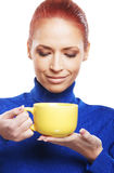Portrait of a young woman holding a yellow cup Stock Photos