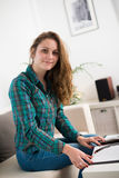 Portrait of a young woman at home Royalty Free Stock Photo