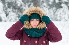 Portrait of a young woman in a hood royalty free stock images
