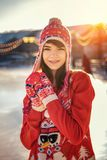 Portrait of a young woman on the ice rink, a smile on his face, the sun stock photography