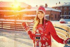 Portrait of a young woman on the ice rink, a smile on his face, the sun stock image