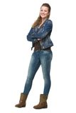Young Woman in Jeans with Arms Crossed Royalty Free Stock Photos