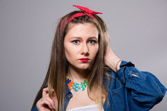 Portrait of a young woman in a jeans jacket royalty free stock images