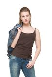 Young Woman with Jeans Jacket over Shoulder Stock Image