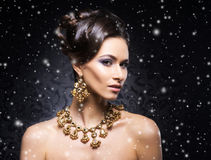 Portrait of a young woman in jewelry on the snow Royalty Free Stock Image