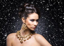Portrait of a young woman in jewelry on the snow Royalty Free Stock Images