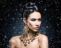 Portrait of a young woman in jewelry on snow Stock Photography