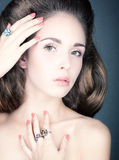 Portrait of a young woman with jewelry. Studio photo of a young woman close up Stock Photography