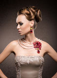 Portrait of a young woman in jewels Royalty Free Stock Photo