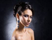 Portrait of a young woman in jewels Royalty Free Stock Image