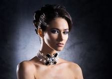 Portrait of a young woman in jewels Stock Photos