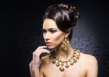 Portrait of a young woman in jewels and makeup Stock Photos