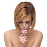Portrait of a young woman kissing a flower Stock Photography