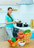 Portrait of young woman in kitchen. Stock Photo