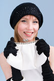 Woman in knit wool hat and mittens with handbag Royalty Free Stock Images