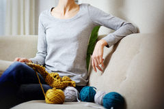 Portrait of a young woman knitting Royalty Free Stock Photography