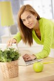 Portrait of young woman with laptop Royalty Free Stock Photo