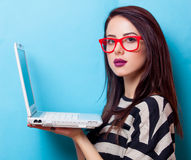 Portrait of a young woman with laptop Stock Photo