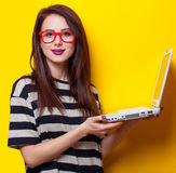 Portrait of a young woman with laptop Stock Photos