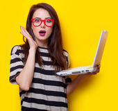 Portrait of a young woman with laptop Stock Photography