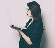 Portrait of the young woman with laptop Stock Photo
