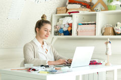 Portrait of a young woman with a laptop. Portrait of a young smiling attractive woman with a laptop, tape on her neck. Concept photo Stock Image