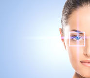Portrait of a young woman with a laser on her eye Stock Photography