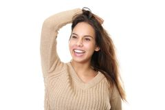 Portrait of a young woman laughing with hands in hair Royalty Free Stock Image