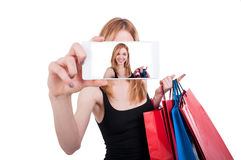 Portrait of young woman laughing with shopping bags Royalty Free Stock Photography