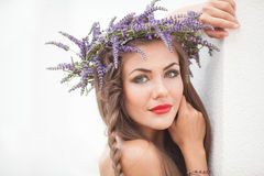 Portrait of young woman in lavender wreath. Fashion, Beauty. Royalty Free Stock Image
