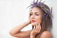 Portrait of young woman in lavender wreath. Fashion, Beauty. Royalty Free Stock Photo