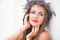 Portrait of young woman in lavender wreath. Fashion, Beauty. Royalty Free Stock Photography