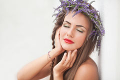 Portrait of young woman in lavender wreath. Fashion, Beauty. Stock Photo