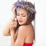 Portrait of young woman in lavender wreath. Fashion, Beauty. Royalty Free Stock Images