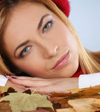 Portrait of a young woman laying on Autumn leaves Royalty Free Stock Images