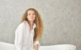 Portrait of a young woman laying in bathtub.relaxed time in bathroom royalty free stock photo