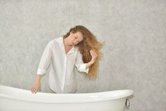 Portrait of a young woman laying in bathtub.relaxed time in bathroom royalty free stock images